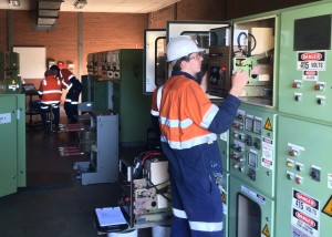 CEC carefully inspect a circuit breaker in the 11,000 Volt Switchroom at a mine near the Central Coast.